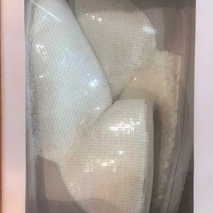 Victoria's Secret sequin boot slippers.